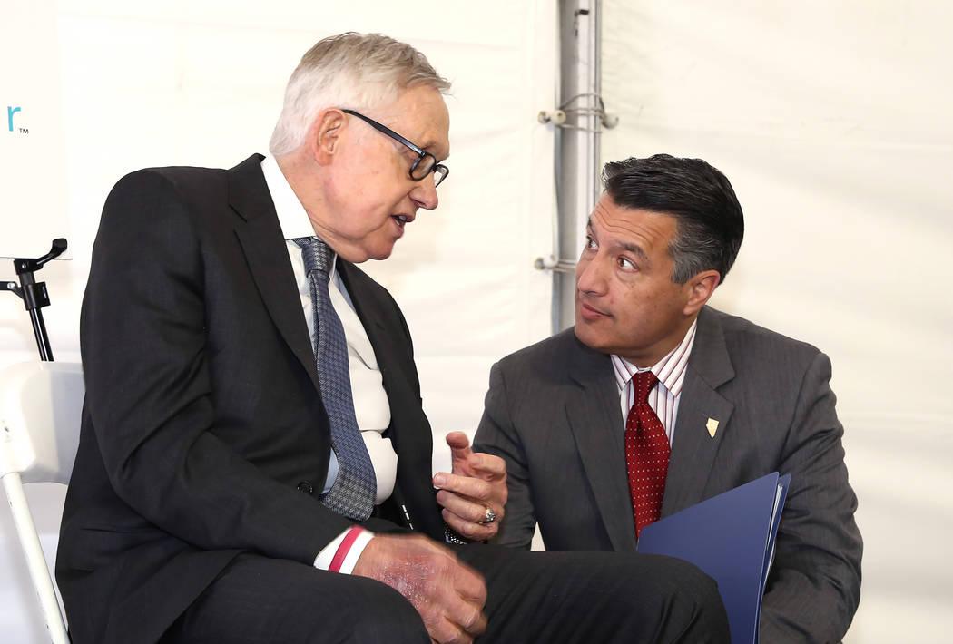 U.S. Senator Harry Reid, D-Nevada, left, and Gov. Brian Sandoval chat prior to the grand opening ceremony of Culinary Health Center on Thursday, June 15, 2017, in Las Vegas. Bizuayehu Tesfaye/Las  ...