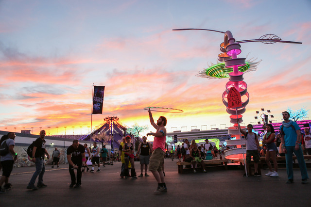 A hoola-hoop preformer dances as attendees of the Electric Daisy Carnival at the Las Vegas Motor Speedway in Las Vegas arrive to the festival Friday evening, June 17, 2016. (Elizabeth Brumley/The  ...