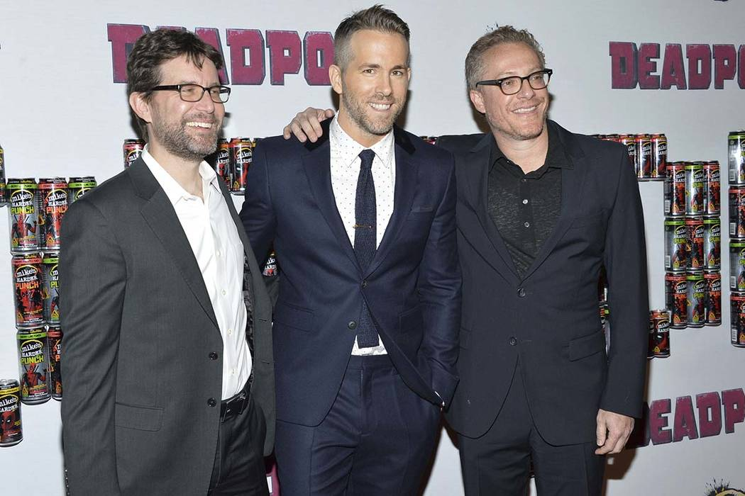 """Ryan Reynolds, center, poses with writers Rhett Reese, left, and Paul Wernick at a special fan screening of """"Deadpool"""" in New York. (Evan Agostini/Invision/AP, File)"""