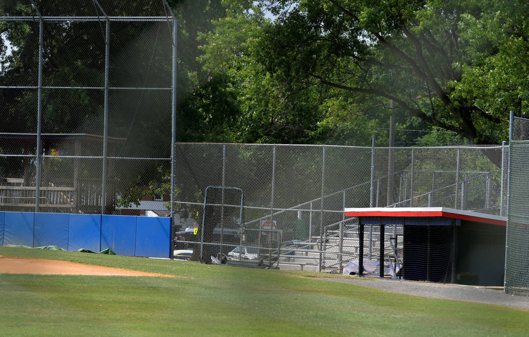 General view of the third-base players dugout and field where shots were fired during a congressional baseball practice, wounding House Majority Whip Steve Scalise (R-LA), in Alexandria, Virginia, ...