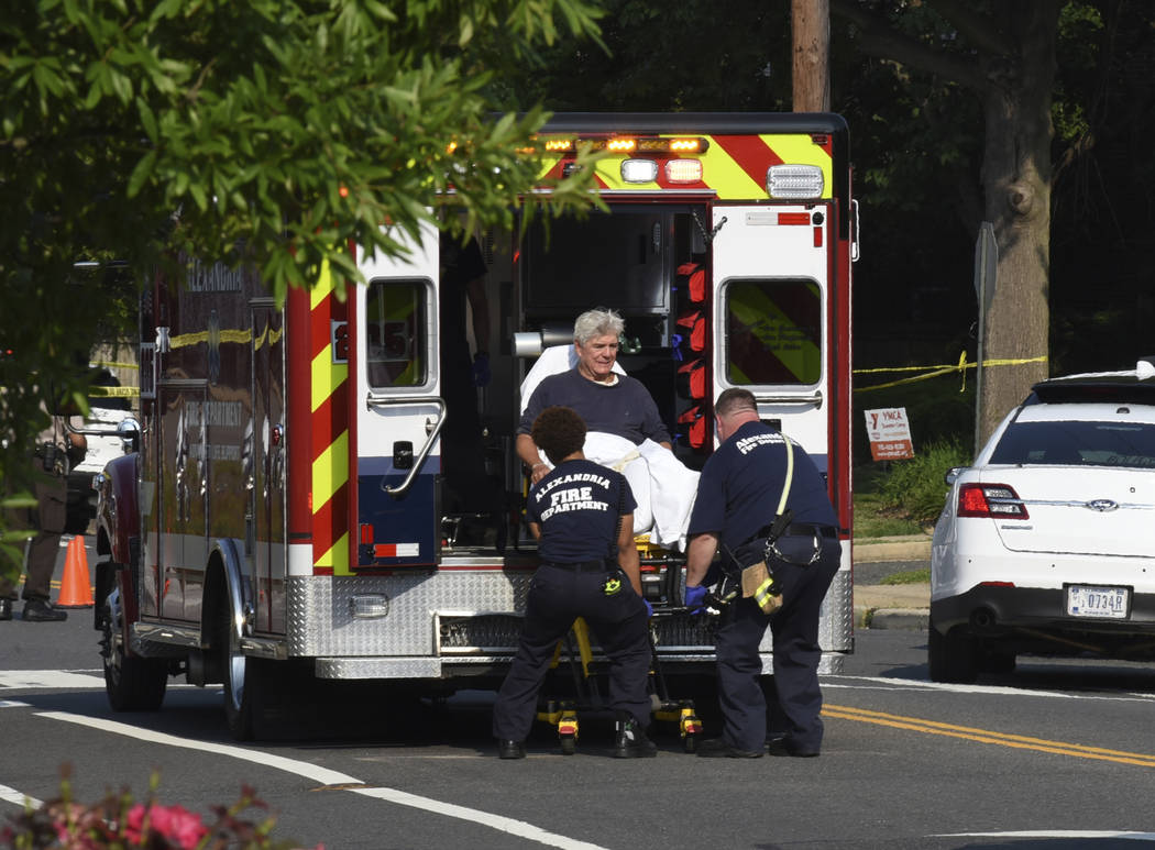 Rep. Roger Williams, R-Texas is placed into an ambulance at the scene of a shooting at a baseball field in Alexandria, Va., Wednesday, June 14, 2017. Members of Congress were practicing for a game ...