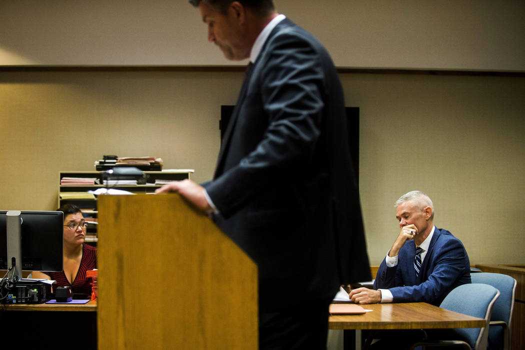 Special Agent Jeff Seipenko, center, listens as Genesee District Judge David Guinn authorizes charges Wednesday, June 14, 2017, in Flint, Mich., for Department of Health and Human Services Directo ...