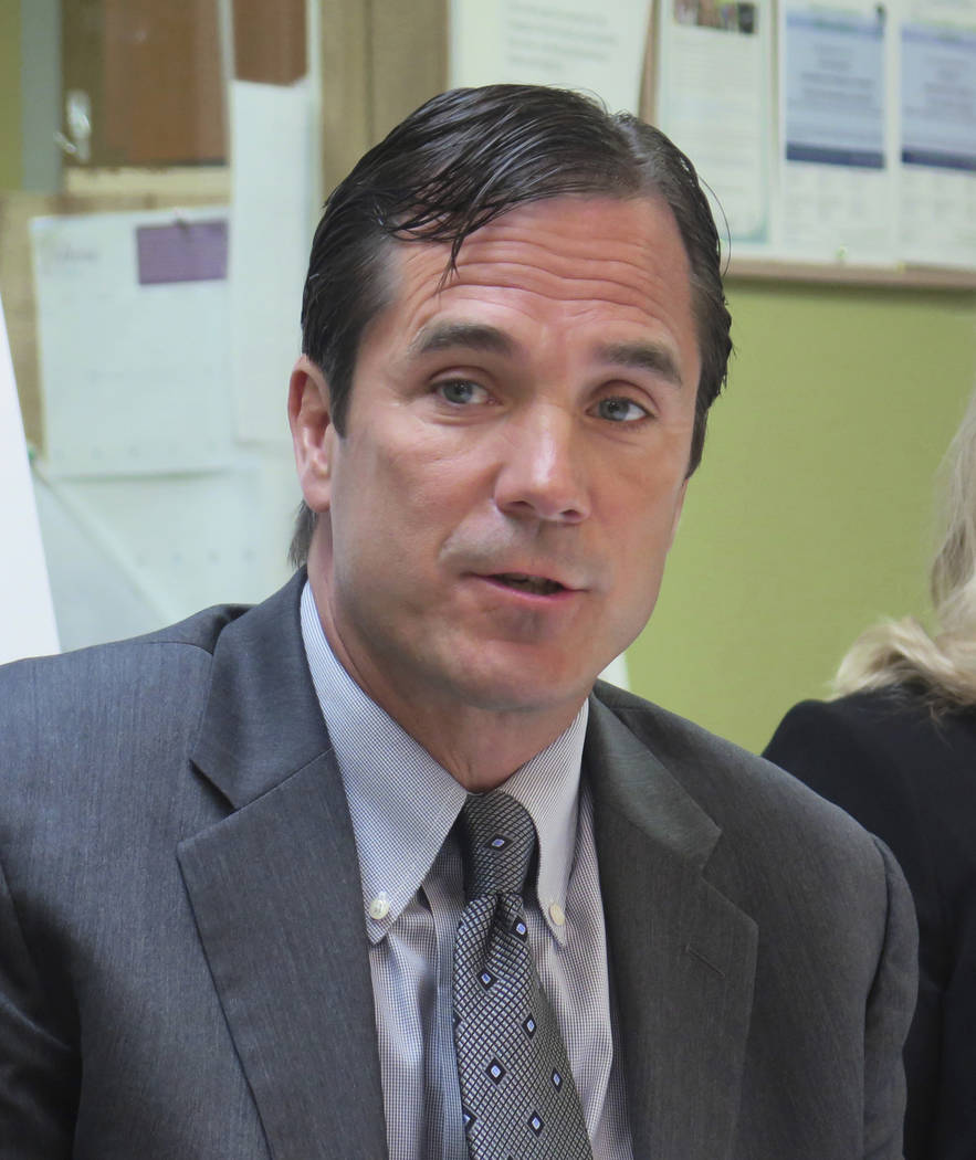 In this June 5, 2017 photo, Nick Lyon, Michigan Health and Human Services Director, speaks in support of the state's Medicaid expansion program in Lansing, Mich. Lyon was charged Wednesday, June 1 ...