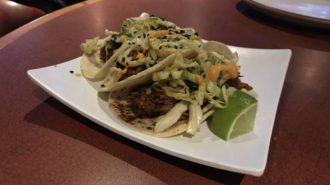 The Tavern's spicy Asian pork street tacos come in sets of three ($8). (Madelyn Reese/View) @MadelynGReese