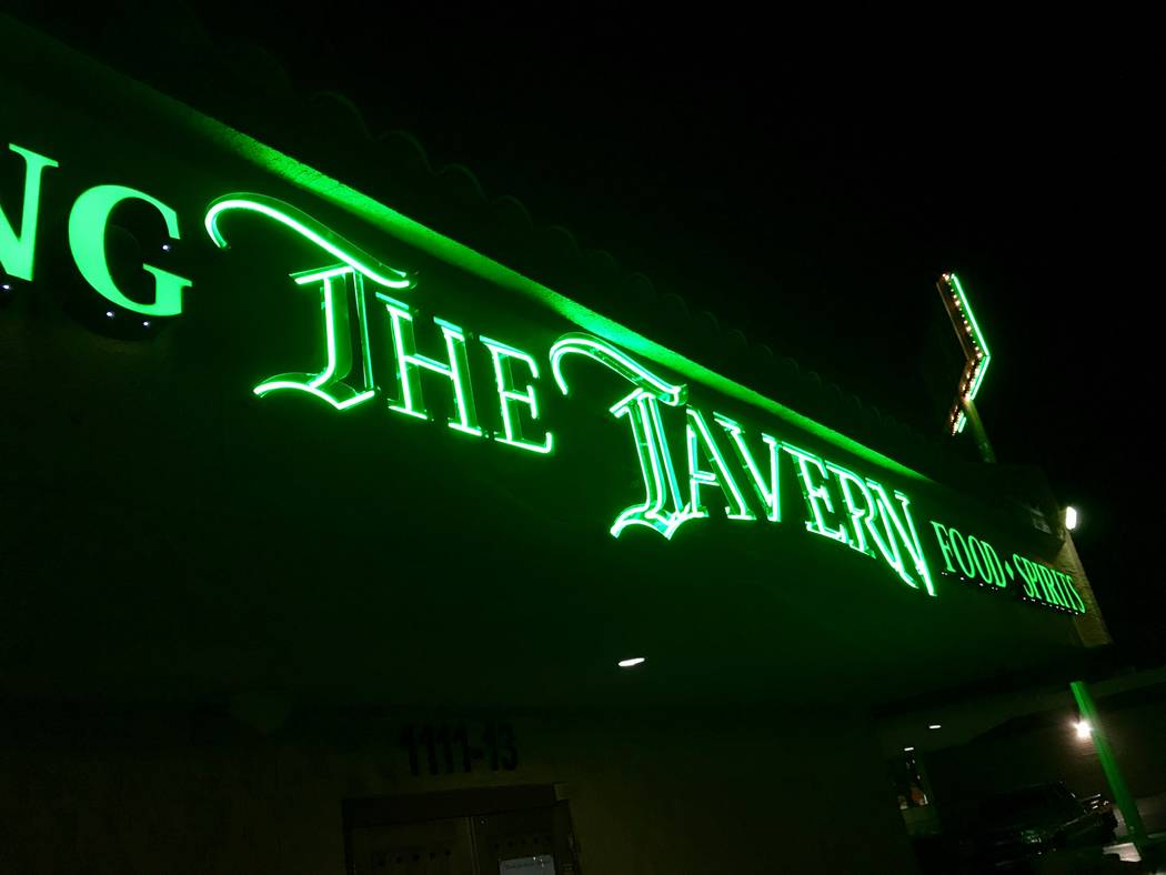 The Tavern's new sign glows above its location on S. Rainbow Boulevard and W. Charleston Boulevard. (Madelyn Reese/View) @MadelynGReese