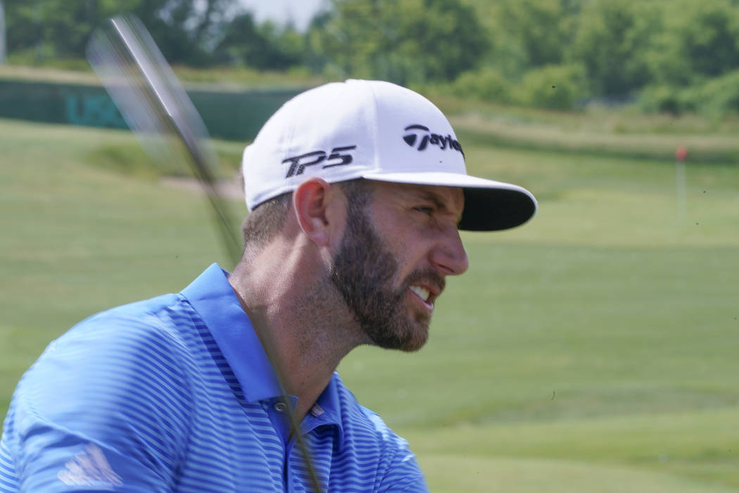Dustin Johnson hits on the range during a practice day for the U.S. Open golf tournament Wednesday, June 14, 2017, at Erin Hills in Erin, Wis. (AP Photo/Morry Gash)
