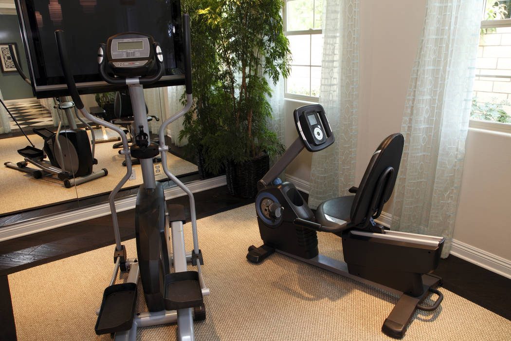 Thinkstock Mirrored wall panels reflect light and give this workout room a more open feel.