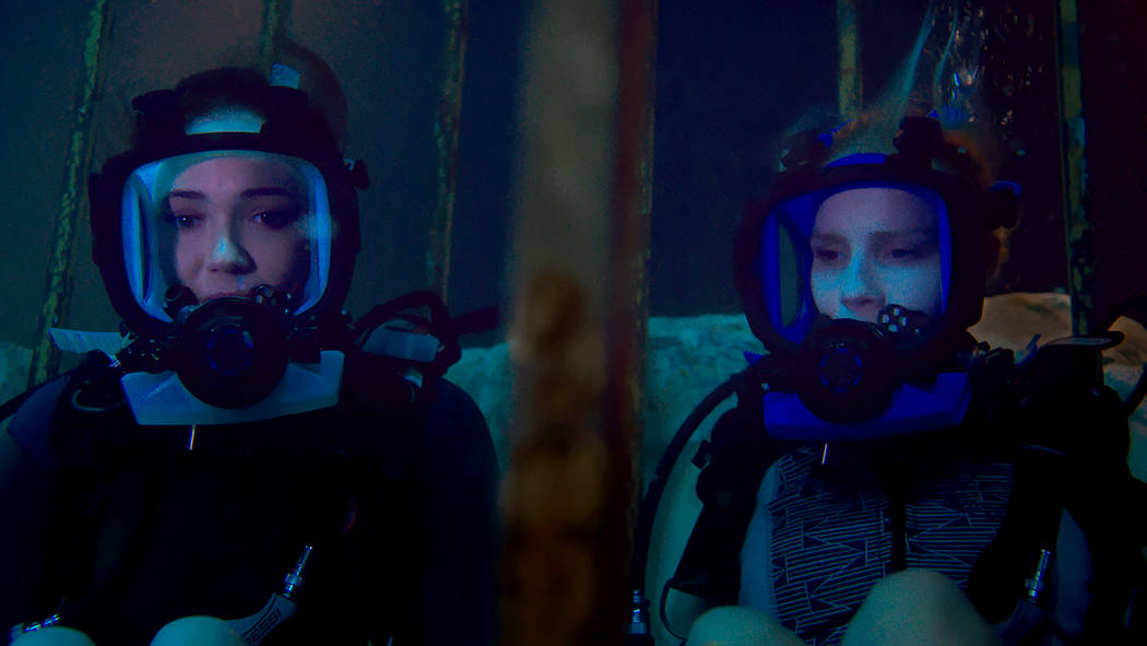 Lisa (Mandy Moore) and Kate (Claire Holt) are stuck at the bottom of the ocean floor after their shark-diving excursion goes terribly wrong in 47 Meters Down. Entertainment Studios Motion Pictures