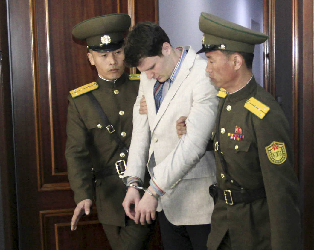 FILE - In this March 16, 2016, file photo, American student Otto Warmbier, center, is escorted at the Supreme Court in Pyongyang, North Korea. Warmbier, whose parents say has been in a coma while  ...
