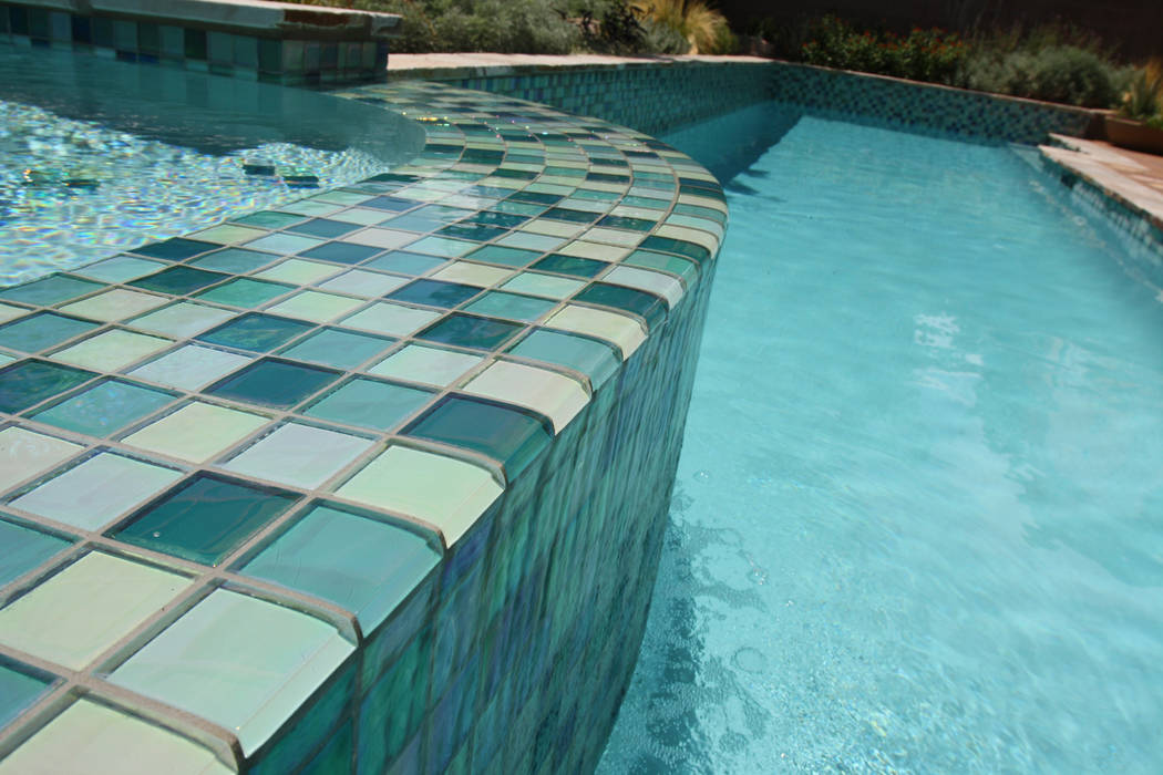 Mary Vail Homeowners can create a lavish look in the pool setting by incorporating a splash of color with bold tile.