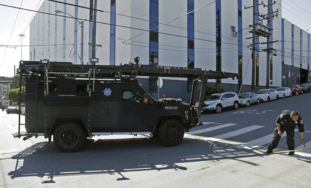 A San Francisco police armored vehicle arrives outside a UPS package delivery warehouse where a shooting took place Wednesday, June 14, 2017, in San Francisco. A UPS spokesman says four people wer ...
