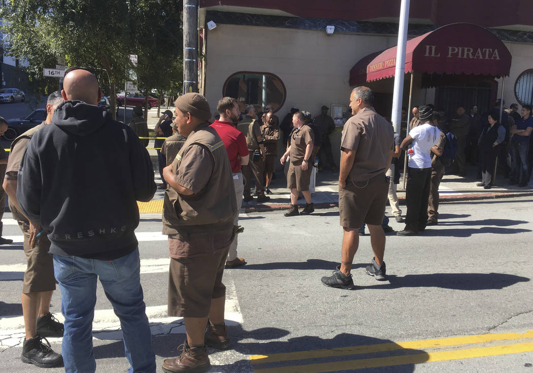 UPS workers gather outside after a reported shooting  at a UPS warehouse and customer service center in San Francisco on Wednesday, June 14, 2017.   San Francisco police confirmed a shooting at th ...