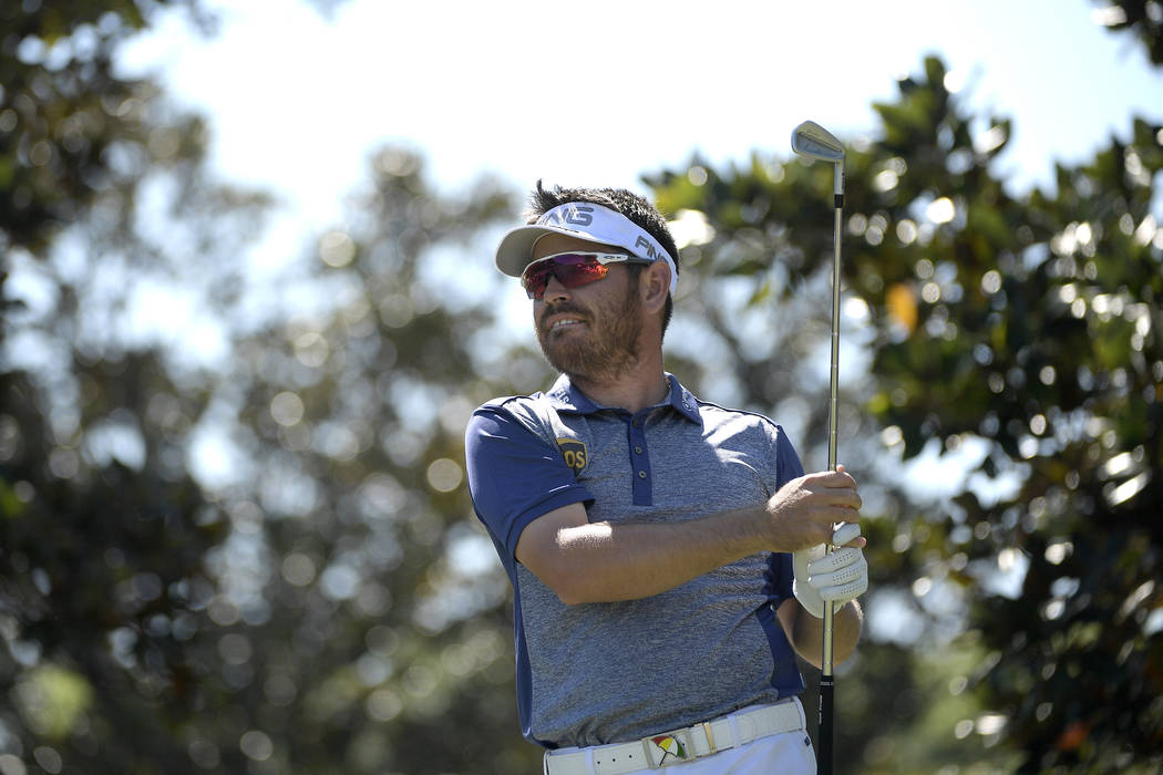 Louis Oosthuizen, of South Africa, watches his tee shot on the second hole during the third round of the Arnold Palmer Invitational golf tournament in Orlando, Fla., Saturday, March 18, 2017. (AP  ...