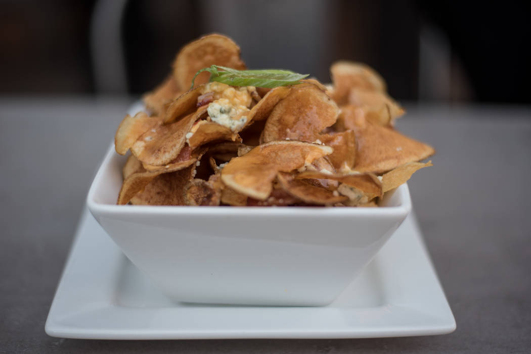The dirty, dirty chips include house-made kettle chips, bleu cheese, bacon, cheese sauce and green onions and cost $7. (Morgan Lieberman/Las Vegas Review-Journal)