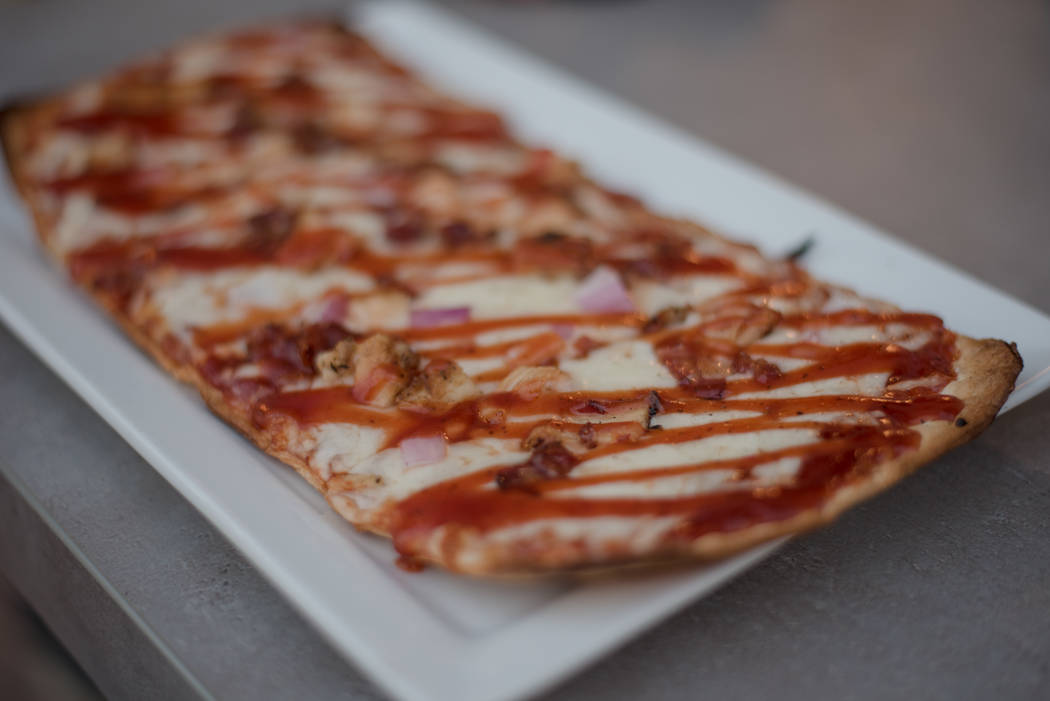 The BBQ flatbread is made up of barbecue sauce, mozzarella, grilled chicken, onion and bacon atop a thin flatbread for $12. (Morgan Lieberman/Las Vegas Review-Journal)