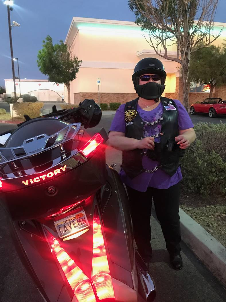 Deedee Shilling of North Las Vegas, who was the first female member of the Vegas Vulcan Riders club to go from being a passenger to a rider, stands by her Vulcan 900 after a monthly meeting in the ...
