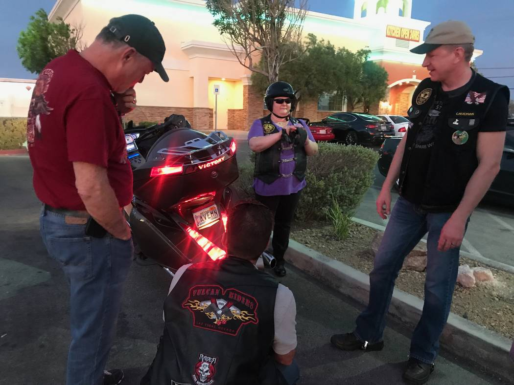 Original founder and former president of Vegas Vulcan Riders, Sam Brown, chats with members right, John, and Deedee, after a monthly meeting in the parking lot of Town Center Lounge II, 2992 W. Ch ...