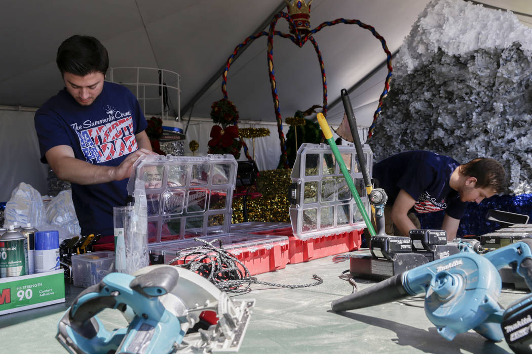 From left: Spencer Day and Cole Willson, volunteers for the Summerlin Council Patriotic Parade, look for tools at Trails Park in Summerlin, Friday, June 30, 2017. Gabriella Angotti-Jones Las Vegas ...