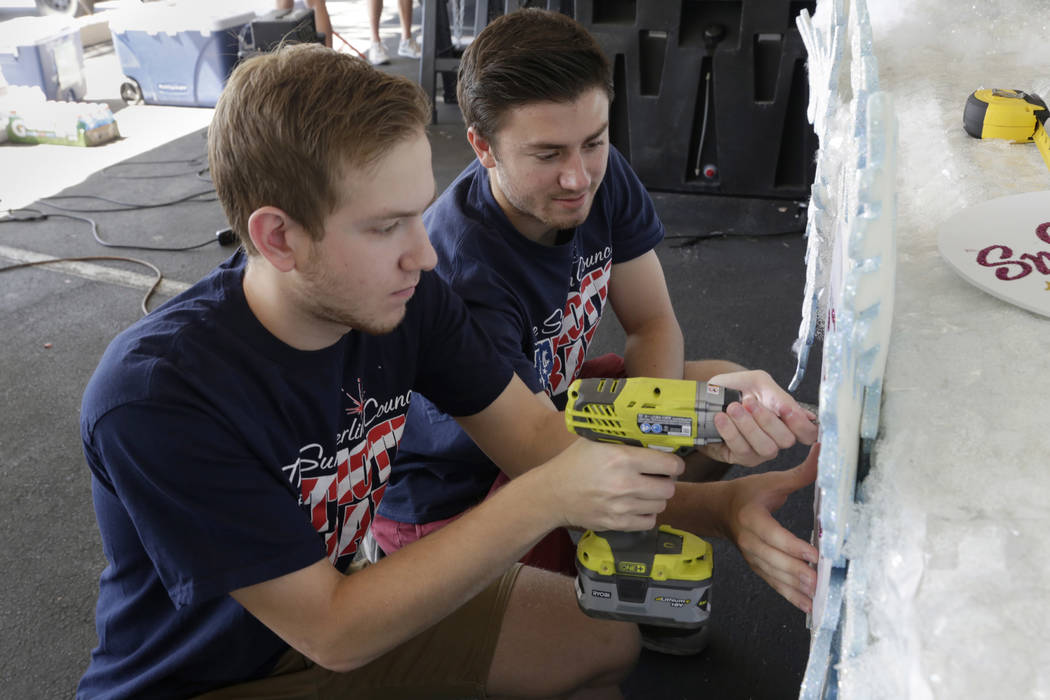 From left: Cole Willson and Spencer Day, volunteers for the Summerlin Council Patriotic Parade, put the finishing touches on floats at Trails Park in Summerlin, Friday, June 30, 2017. Gabriella An ...