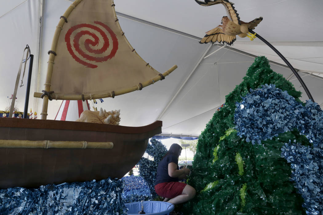 A volunteer for the Summerlin Council Patriotic Parade  puts the finishing touches on a Moana themed float at Trails Park in Summerlin, Friday, June 30, 2017. Gabriella Angotti-Jones Las Vegas Rev ...
