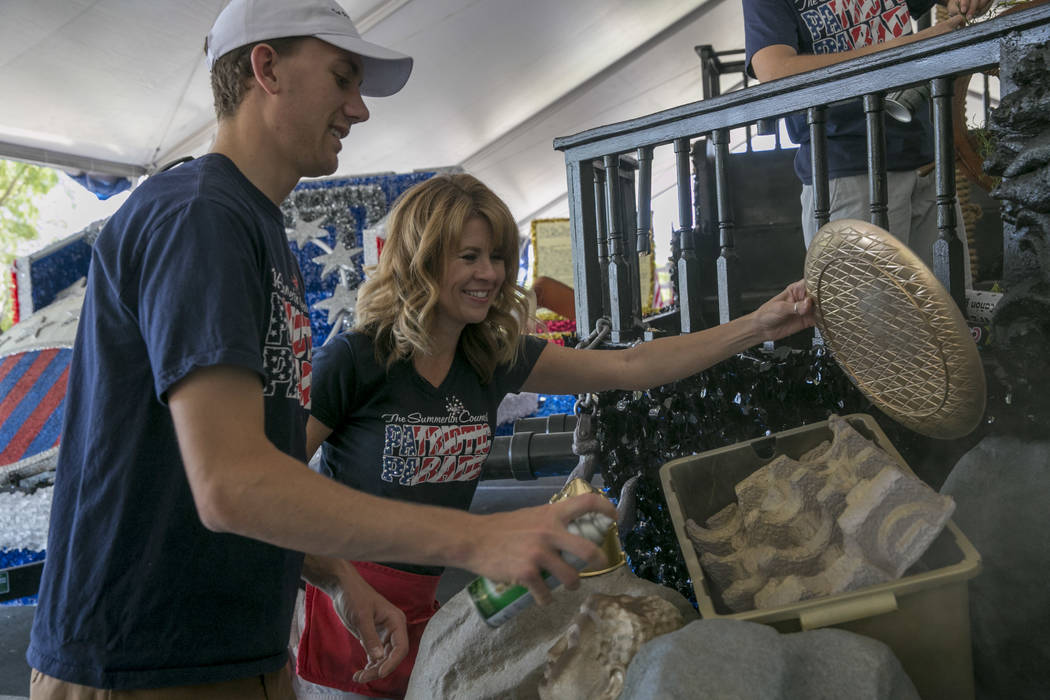 From left: Spencer Felton and Elizabeth Engle, volunteers for the Summerlin Council Patriotic Parade, put the finishing touches on a pirate-themed float at Trails Park in Summerlin, Friday, June 3 ...