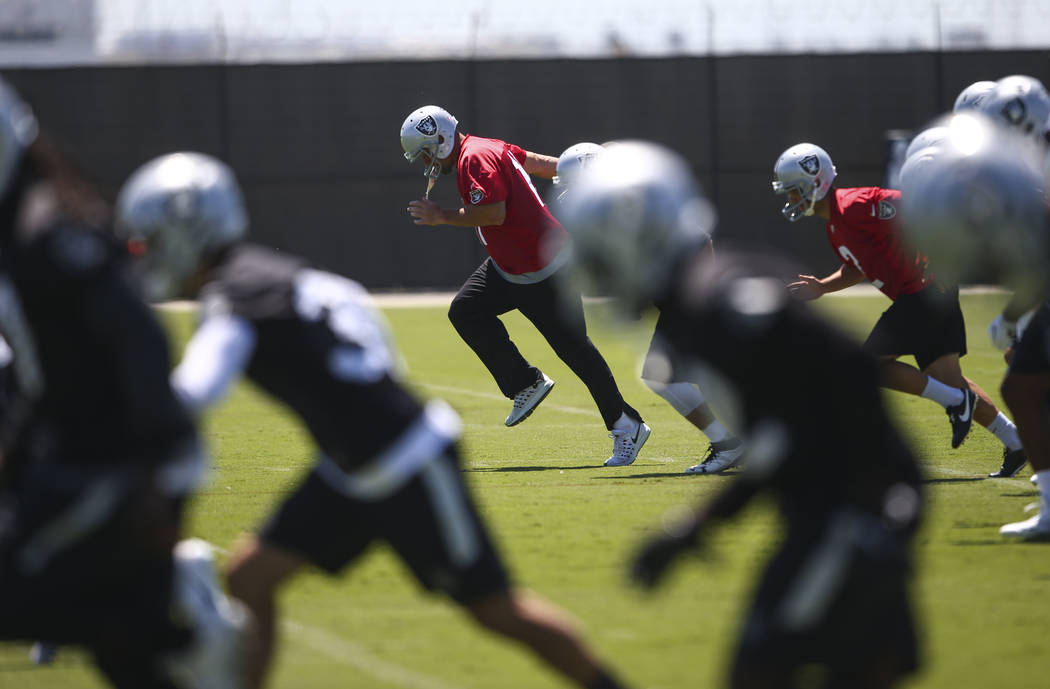 Oakland Raiders kicker Sebastian Janikowski, center, warms up during day two of a mini-camp at the Raiders headquarters and training facility in Alameda, Calif. on Wednesday, June 14, 2017. Chase  ...
