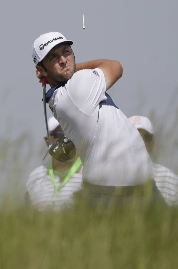 Jon Rahm, of Spain, hits a drive on the 18th hole during a practice round for the U.S. Open golf tournament Wednesday, June 14, 2017, at Erin Hills in Erin, Wis. (AP Photo/David J. Phillip)