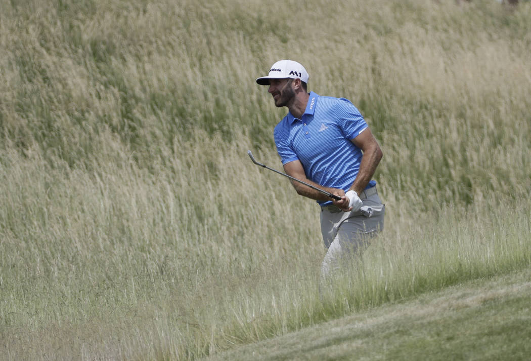 Dustin Johnson hits from some tall fescue on the 12th hole during a practice round for the U.S. Open golf tournament Wednesday, June 14, 2017, at Erin Hills in Erin, Wis. (AP Photo/David J. Phillip)