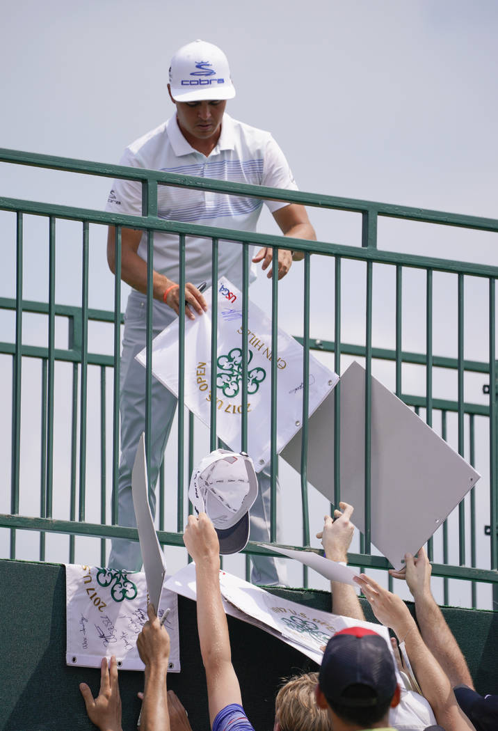 Rickie Fowler signs autographs after a practice round for the U.S. Open golf tournament Monday, June 12, 2017, at Erin Hills in Erin, Wis. (AP Photo/Morry Gash)