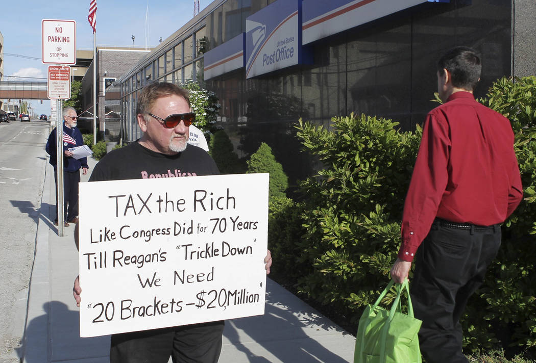 James Hodgkinson of Belleville, Illinois, protests outside of the U.S. Post Office in the city's downtown area. A government official says the suspect in the Virginia shooting that injured Rep. St ...