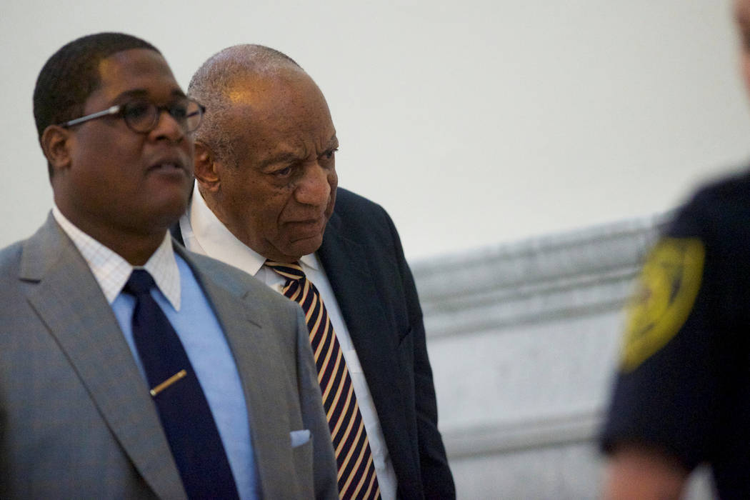 Bill Cosby exits the courtroom with his publicist Andrew Wyatt on the third day of jury deliberations in his sexual assault trial at the Montgomery County Courthouse in Norristown, Pennsylvania, U ...