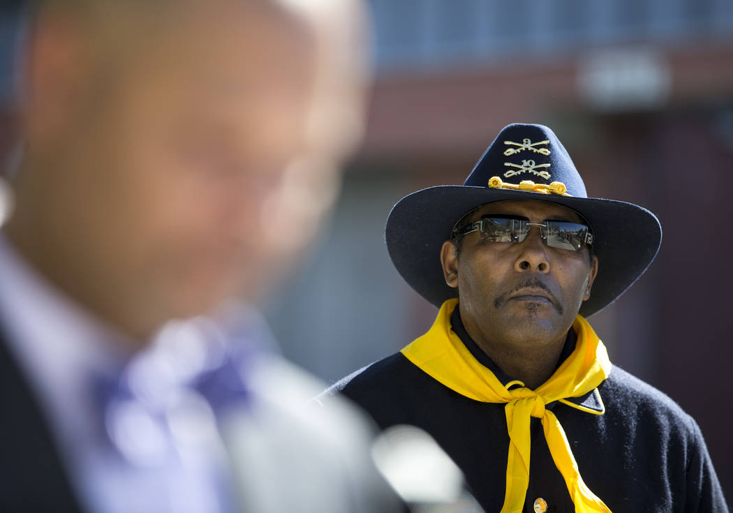 Southern Nevada Buffalo Soldiers Assistant Quartermaster Kelly Hawthorne looks on as Sen. Aaron D. Ford, D-Nev., speaks during a Juneteenth flag raising ceremony outside Las Vegas City Hall in dow ...