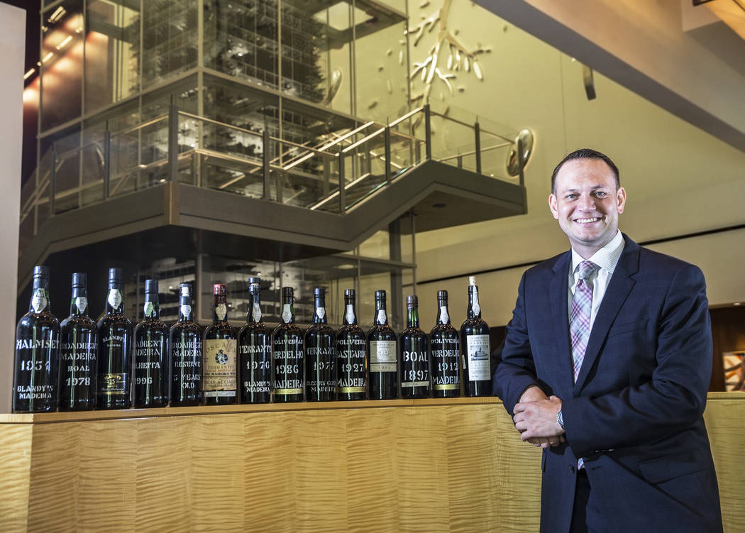 Harley Carbery, director of wine at Mandalay Bay hotel-casino, with a collection of rare madeiras at Aureole on Wednesday, June 14, 2017, at the Mandalay Bay hotel-casino, in Las Vegas. Aureole of ...