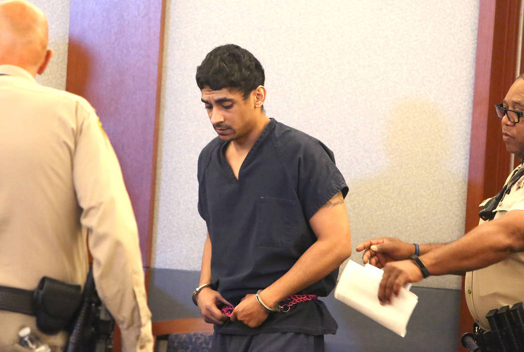 Jason Quate, who is accused of trafficking his wife for prostitution, is led into the courtroom for his initial court appearance at the Regional Justice Center on Friday, June 9, 2017, in Las Vega ...