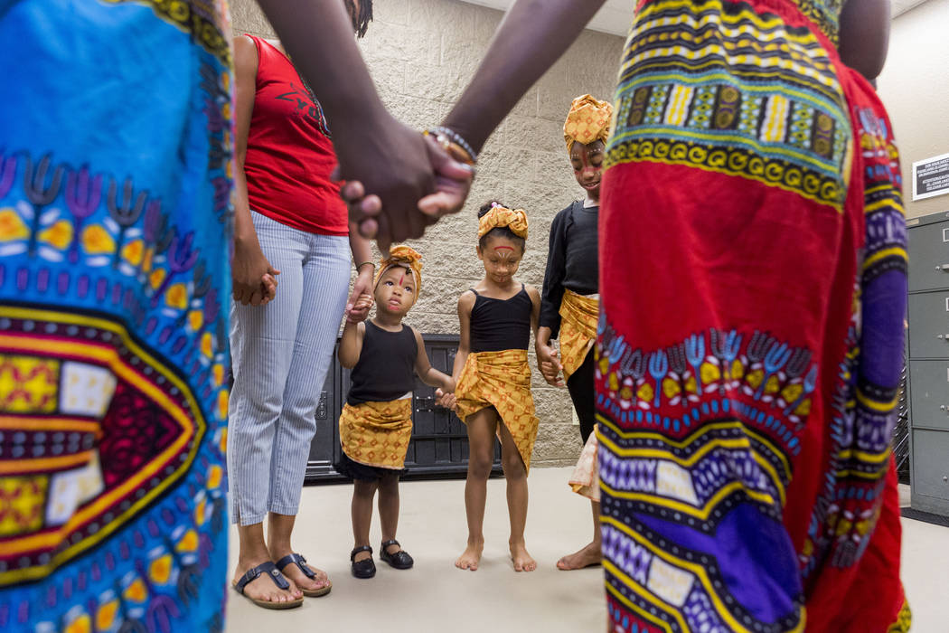 Olabisi African Dance Ensemble hold hands before they perform during the National Juneteenth Observance celebration of Juneteenth at the West Las Vegas Library, Sunday, June 18, 2017. Elizabeth Br ...