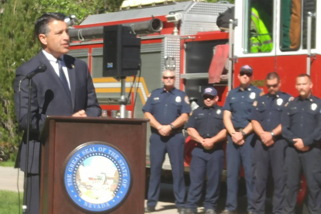 Gov. Brian Sandoval speaks Wednesday outside the State Capitol in Carson City before signing bills that will create a memorial for firefighters and put enhanced penalties in place for crimes again ...