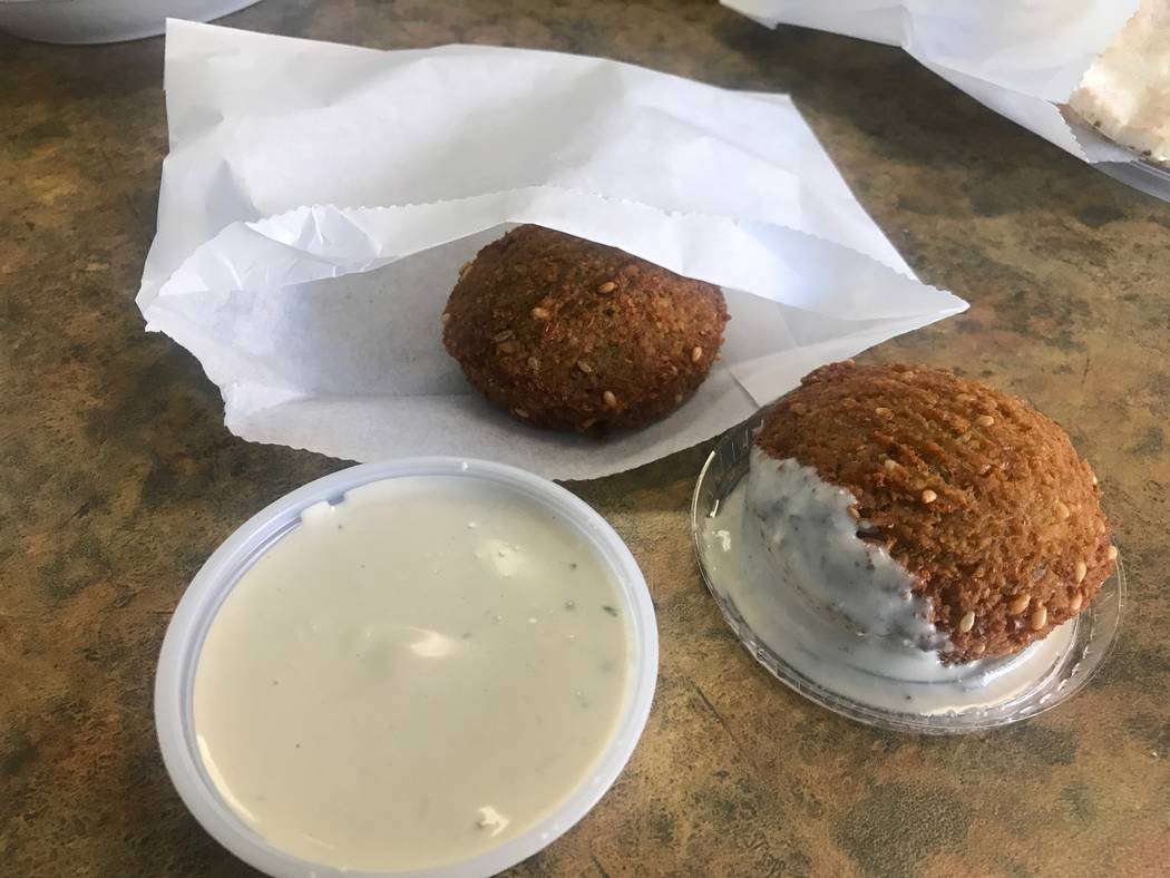 Falafels are served with a tahini sauce at Baladie Cafe, 4872 W. Lone Mountain Road. (Kailyn Brown/View) @KailynHype