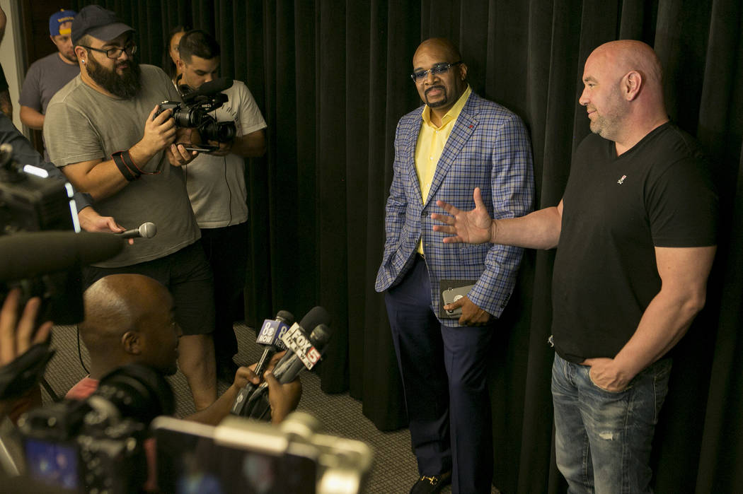 CEO of Mayweather Promotions Leonard Ellerbe, left, and UFC president Dana White, right, announce a Floyd Mayweather Jr. and Conor McGregor fight on Wednesday, June 14, 2017 in Las Vegas. The flig ...