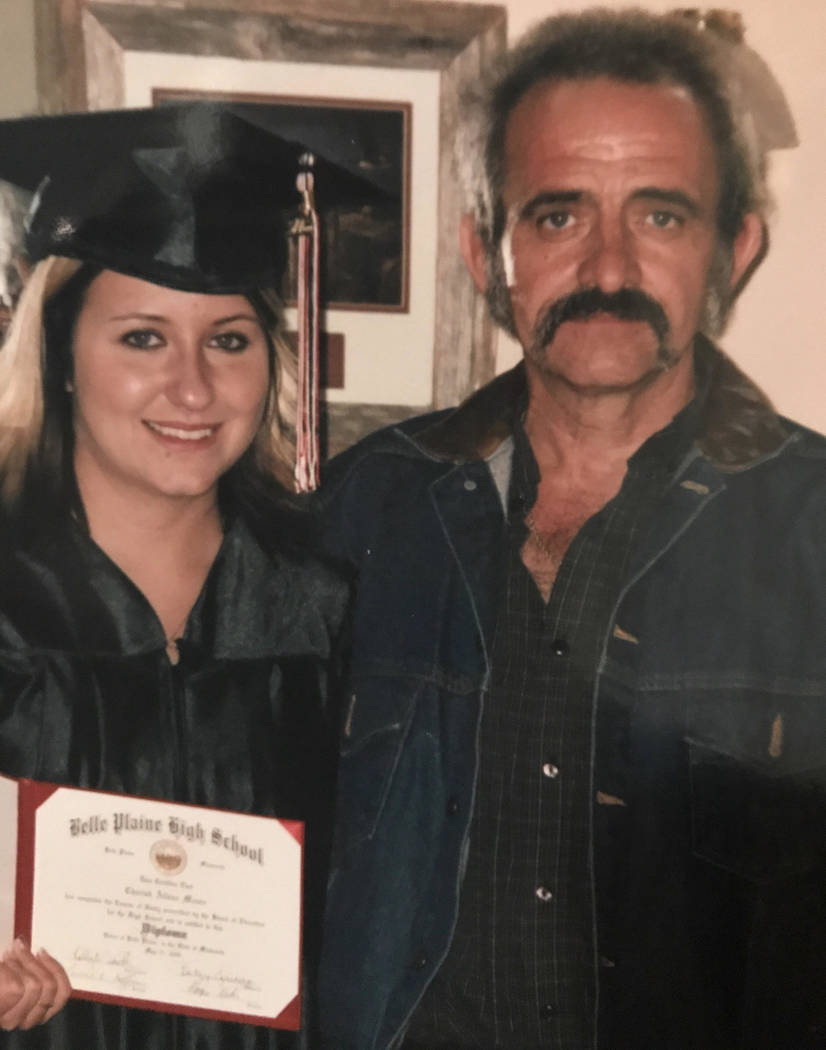"""Jerry Lee Moore with his daughter, Cherish Moore, now 29, after her high school graduation. He was fatally shot in the head while handcuffed June 5 in what homicide detectives have called an """"exec ..."""