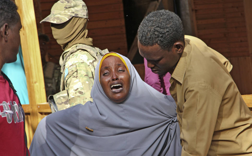 A mother whose daughter was shot in the head by attackers during a militant attack on a restaurant, grieves in Mogadishu, Somalia Thursday, June 15, 2017. Somalia's security forces early Thursday  ...