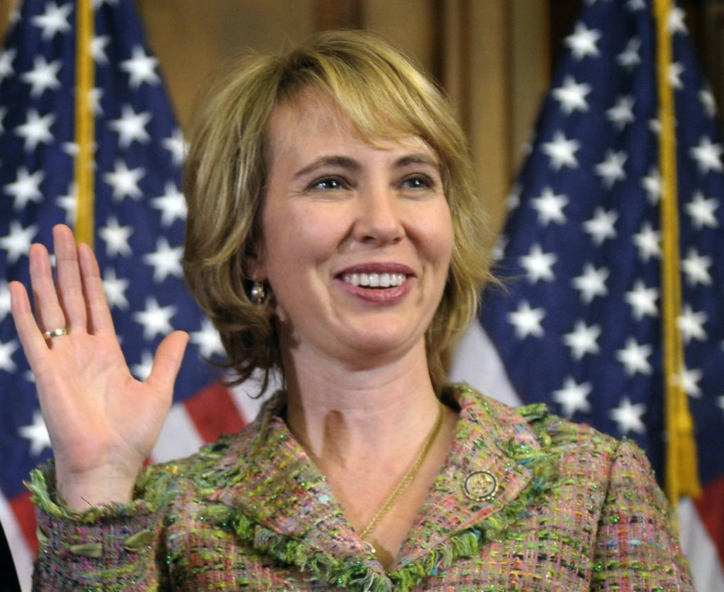 In this Jan. 5, 2011 file photo, Rep. Gabrielle Giffords, D-Ariz., takes part in a re-enactment of her swearing-in on Capitol Hill in Washington on Jan. 5, 2011.  Three days later, she was shot in ...