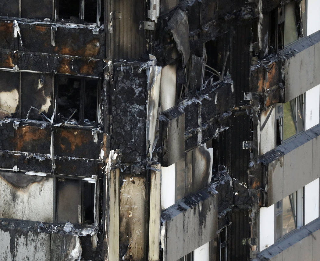 The remains of the burnt down Grenfell Tower are seen in London, Thursday, June 15, 2017. A massive fire raced through the 24-story high-rise apartment building in west London early Wednesday. (Fr ...
