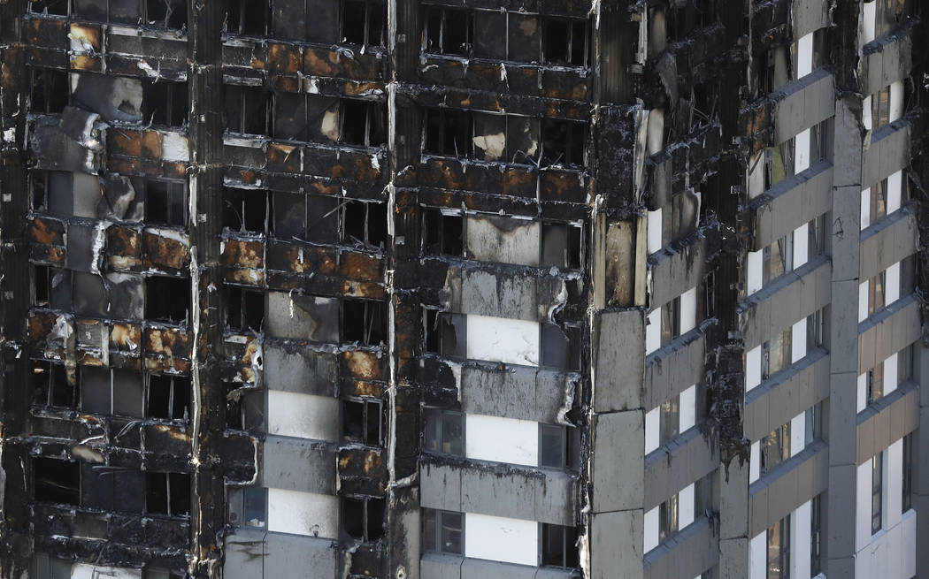The fire-damaged Grenfell Tower stands in London, Thursday, June 15, 2017. A massive fire raced through the 24-story high-rise apartment building in west London early Wednesday.(AP Photo/Frank Aug ...
