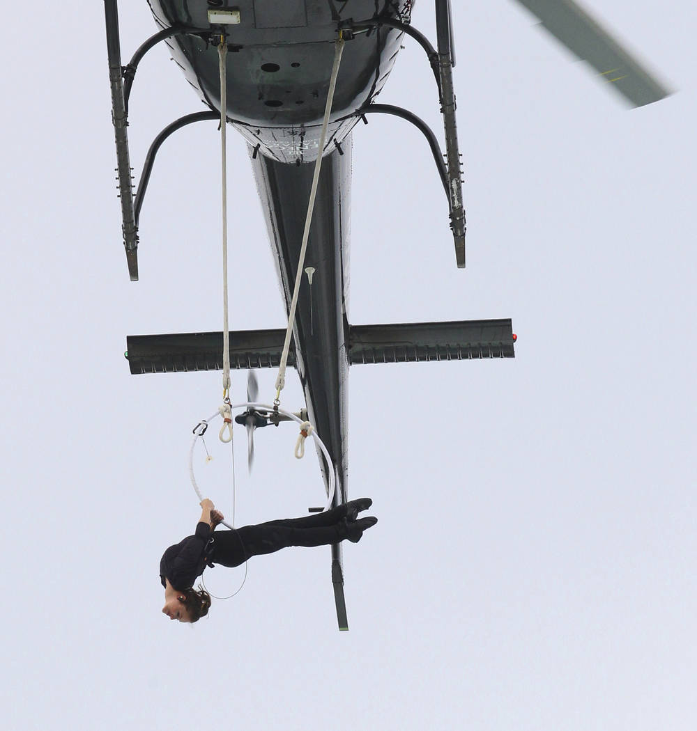 Erendira Wallenda performs a series of acrobatic maneuvers, including hanging by her teeth, while suspended from a helicopter above Niagara Falls in Niagara Falls, N.Y., Thursday, June 15, 2017. T ...