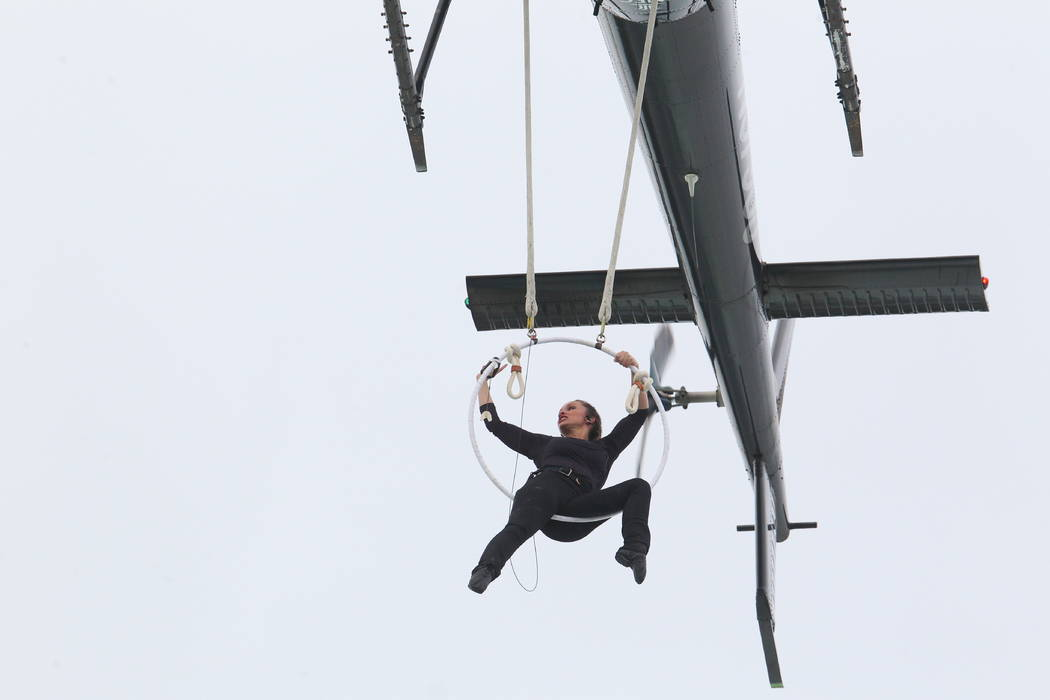 Erendira Wallenda performs a series of acrobatic maneuvers, including hanging by her teeth, while suspended from a helicopter above Niagara Falls in Niagara Falls, N.Y., Thursday, June 15, 2017.   ...