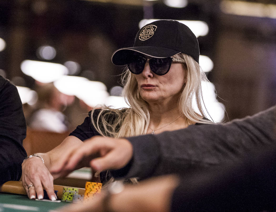 A woman looks at her hand during the opening of the World Series of Poker at the Rio Convention Center on Wednesday, May 31, 2017. Patrick Connolly Las Vegas Review-Journal @PConnPie