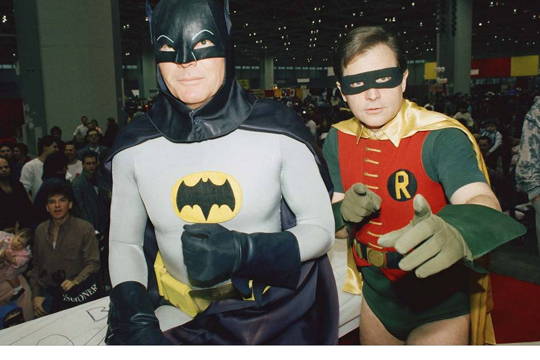 In honor of Adam West, left, who played Batman on TV and died last week, Los Angeles Mayor Eric Garcetti said the Bat-Signal will shine over the city on Thursday, June 15, 2017. Burt Ward portraye ...