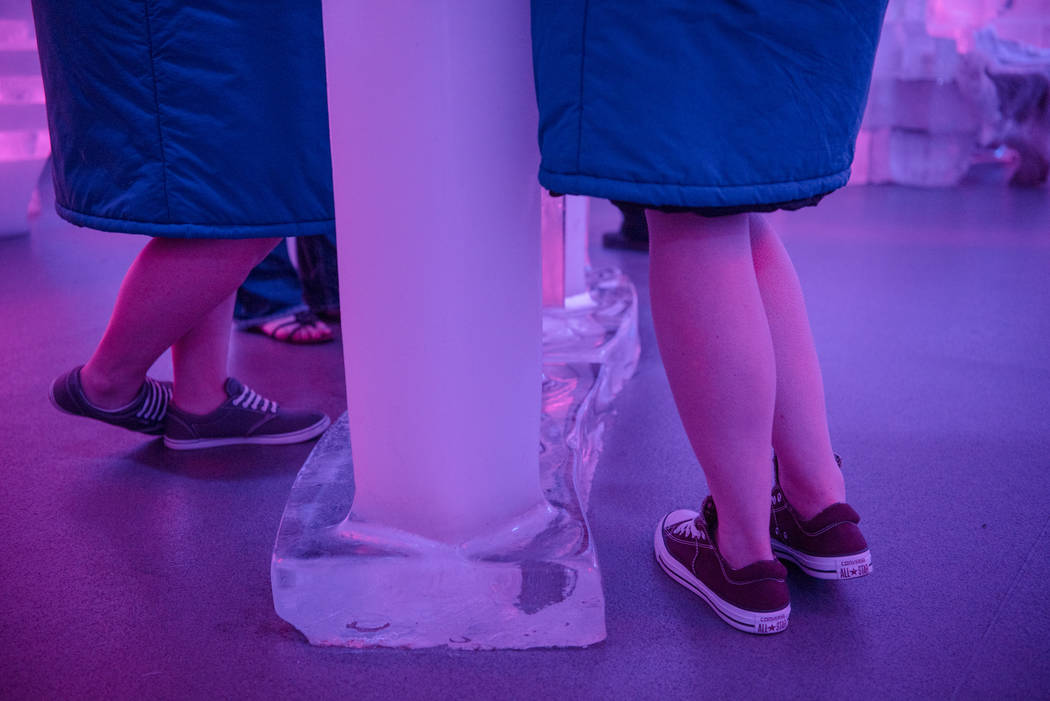 Attendees of the Minus 5 Ice Experience bar at Mandalay Bay Resort and Casino brave the cold with tennis shoes on Thursday, June 15, 2017, in Las Vegas. Morgan Lieberman Las Vegas Review-Journal