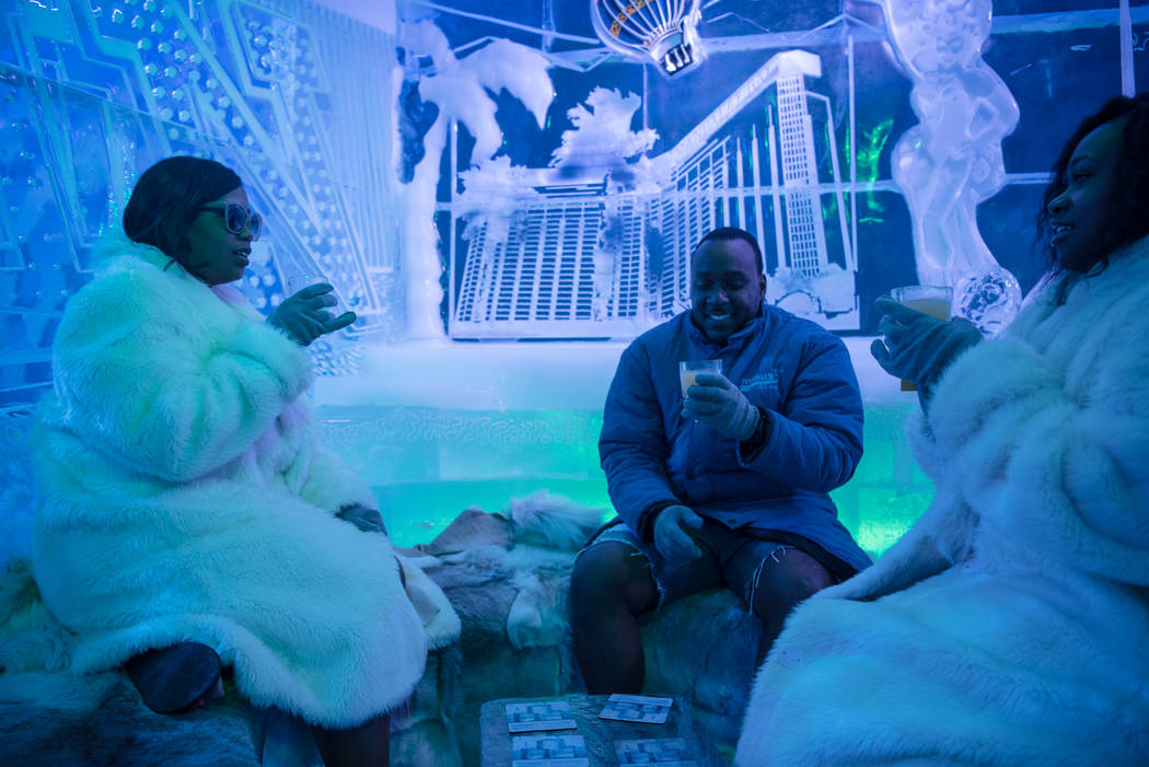 Kendra Gilbert, Kevin Gilbert, and Krishona Gilbert take a break from the heat at the Minus 5 ice bar at Mandalay Bay Resort and Casino on Thursday, June 15, 2017, in Las Vegas. Peter Slavin, a ma ...
