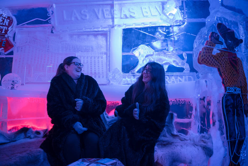 Meredith Cormack and Kara Palmer bundle up for cold weather in the Minus 5 ice bar at Mandalay Bay Resort and Casino while the heat wave outside continues on Thursday, June 15, 2017, in Las Vegas. ...